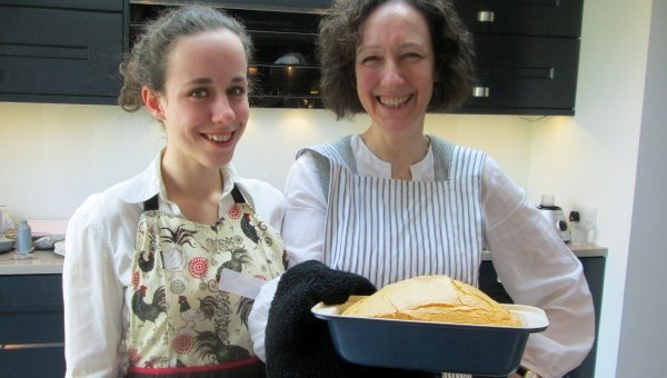 Chloe and Afifah presenting a grain free and nut free loaf - straight out of the oven