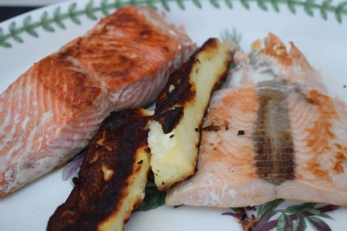 Wild Salmon Fillet with halloumi 'chips' on a plate
